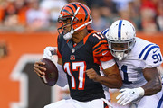 Jason Campbell #17 of the Cincinnati Bengals is sacked by Jonathan Newsome #91 of the Indianapolis Colts during the first quarter at Paul Brown Stadium on August 28, 2014 in Cincinnati, Ohio.