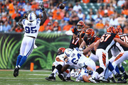 Phillip Hunt #95 of the Indianapolis Colts attempts to knock down a pass from Jason Campbell #17 of the Cincinnati Bengals during the first quarter at Paul Brown Stadium on August 28, 2014 in Cincinnati, Ohio.
