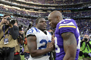 Frank Gore #23 of the Indianapolis Colts and Adrian Peterson #28 of the Minnesota Vikings greet each other after the game on December 18, 2016 at US Bank Stadium in Minneapolis, Minnesota. The Colts defeated the Vikings 34-6.
