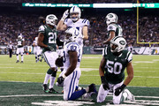 Dwayne Allen #83 of the Indianapolis Colts celebrates his touchdown with teammates in the second quarter against the New York Jets during their game at MetLife Stadium on December 5, 2016 in East Rutherford, New Jersey.