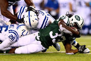 Running back Chris Ivory #33 of the New York Jets carries the ball against the Indianapolis Colts during a preseason game at MetLife Stadium on August 7, 2014 in East Rutherford, New Jersey.