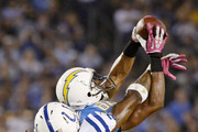 SAN DIEGO, CA-OCTOBER-14:  Wide receiver Vincent Brown #86 of the San Diego Chargers makes a 16-yard first down catch against Greg Toler #28 of the Indianapolis Colts during the second quarter at Qualcomm Stadium October 14, 2013 in San Diego, California.
