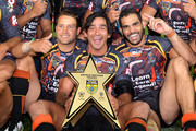 Johnathan Thurston, Greg Inglis and Tyrone Roberts of the Indigenous All Stars celebrate victory after the NRL pre-season match between the Indigenous All Stars and the NRL All Stars at Cbus Super Stadium on February 13, 2015 in Gold Coast, Australia.