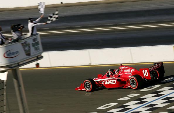 Dario Franchitti Dario Franchitti driver of the #10 Target Chyip Ganassi Racing Dallara Honda crosses the finish line to win the IRL IndyCar Series Indy Grand Prix of Sonoma at the Infineon Raceway on August 23, 2009 in Sonoma, California.