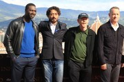"""From left : Actors Omar Sy, Irrfan Khan, director Ron Howard, actor Tom Hanks, pose during a photocall on the eve of the World Premiere of the movie """"Inferno"""" on October 7, 2016 in Florence.  / AFP / Giusi Sproviero"""