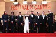 (L-R) Actor Garrett Hedlund, director Joel Coen, actor Oscar Isaac, actress Carey Mulligan, actor Justin Timberlake, director Ethan Coen, actor John Goodman and musician T-Bone Burnett attend 'Inside Llewyn Davis' Premiere during the 66th Annual Cannes Film Festival at Palais des Festivals on May 19, 2013 in Cannes, France.