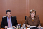 German Chancellor Angela Merkel and Germans Foreign Minister Sigmar Gabriel arrive for a cabinet meeting of Germany's interim government on January 10, 2018 in Berlin, Germany. Merkel is currently seeking to build a new coalition government between her party, the German Christian Democrats (CDU), its sister party, the Bavarian Social Union (CSU), and the German Social Democrats (SPD).