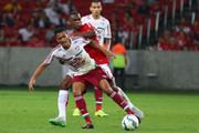 Juan of Internacional battles for the ball against Cicero of Fluminense during the match between Internacional and Fluminense as part of Brasileirao Series A 2015, at Estadio Beira-Rio on August 12, 2015, in Porto Alegre, Brazil.