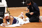 Caroline Wozniacki of Denmark receives treatment during her first round match against Danielle Collins of the USA during day three of the International BNL d'Italia at Foro Italico on May 14, 2019 in Rome, Italy.