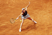 Caroline Wozniacki of Denmark stretches for a forehand during her first round match against Danielle Collins of the USA during day three of the International BNL d'Italia at Foro Italico on May 14, 2019 in Rome, Italy.