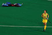 Madonna Blyth of Australia runs back to the midfield after scoring a goal as Farah Ayuni Yahya of Malaysia lies on the ground during the match between Australia and Malaysia on day two of the International Superseries at Perth Hockey Stadium on October 21, 2011 in Perth, Australia.