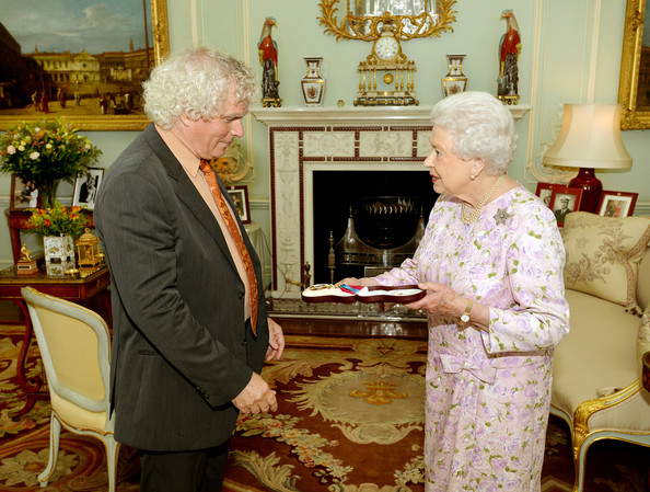 Sir Simon Rattle during a private audience with Queen Elizabeth II where she presents him with the Insignia of a Member of the Order of Merit at Buckingham Palace on July 22, 2014 in London, England.