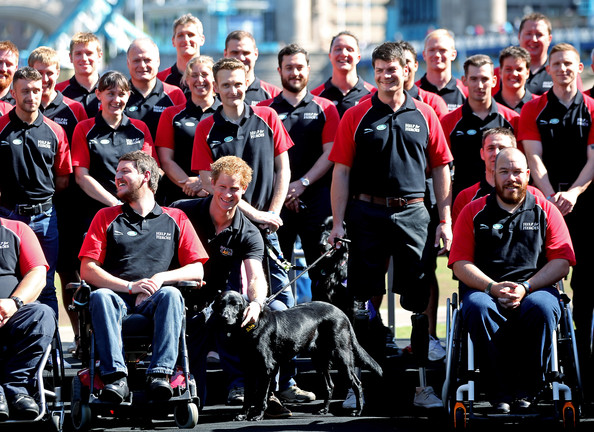 HRH Prince Harry with British Armed Forces team captain Dave Henson during the British Armed Forces team announcement for the Invictus Games at Potters Field, tower bridge on August 13, 2014 in London, England.