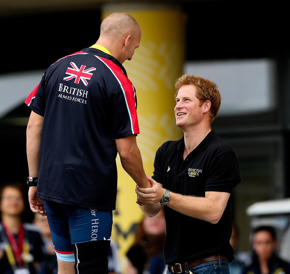 Prince Harry presents Terry Byrne of Great Britain with his medal during the Road Cycling on Day Three of the Invictus Games at Olympic Park on September 13, 2014 in London, England.