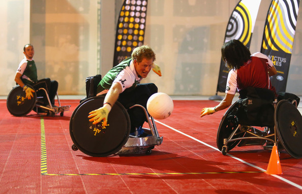 (STRICTLY EMBARGOED FOR PUBLICATION UNTIL 7PM BST) Prince Harry stretches for the ball during a training session for the Jaguar Land Rover Exhibition Wheelchair Rugby Match on day 2 of the Invictus Games, presented by Jaguar Land Rover at Queen Elizabeth Olympic Park on September 12, 2014 in London, England.