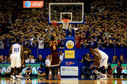 Kansas Jayhawks fans attempt to distract as A.J. English #5 of the Iona Gaels dhoots a free throw during the game at Allen Fieldhouse on November 19, 2013 in Lawrence, Kansas.