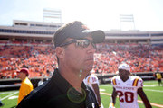 Mike Gundy, head coach of the  Oklahoma State Cowboys leaves the field after the game against the Iowa State Cyclones October 4, 2014 at Boone Pickens Stadium in Stillwater, Oklahoma. Oklahoma State defeated Iowa State 37-20.