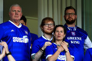 Musician Ed Sheeran and fiance Cherry Seaborn look on during the Sky Bet Championship match between Ipswich Town and Aston Villa at Portman Road on April 21, 2018 in Ipswich, England.
