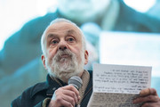 British writer and director Mike Leigh addresses the crowd as thousands gather to watch a free screening and UK premier of Iranian film The Salesman in Trafalgar Square on February 26, 2017 in London, England. The film's director Asghar Farhadi said that he would boycott the Oscars ceremony, held tonight in Hollywood, in protest of US President Donald Trump's immigration policy.