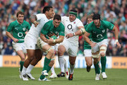 David Wallace of Ireland moves away from Manu Tuilagi (L) and Hendre Fourie during the international match between Ireland and England at the Aviva Stadium on August 27, 2011 in Dublin, Ireland,