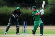 Paul Stirling of Ireland in action as Maurice Ouma of Kenya watches during the ICC World Cricket League Division One match between Ireland and Kenya at the Rotterdam VOC on July 1, 2010 in Rotterdam, Netherlands.