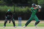 Alex Cusack of Ireland in action as Maurice Ouma of Kenya watches during the ICC World Cricket League Division One match between Ireland and Kenya at the Rotterdam VOC on July 1, 2010 in Rotterdam, Netherlands.