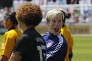 Captain Megan Rapinoe of the United States reacts as she walks onto the pitch with her mom, Denise Rapinoe, on Mother's Day during introductions before a friendly match against Ireland on Mother's Day, May 10, 2015 at Avaya Stadium in San Jose, California.  The U.S. won 3-0.