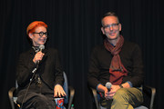 Sandy Powell and Christopher Peterson speak onstage at 'The Irishman' Exhibit and All Guild Q&A Reception at Landmark Theatre on December 10, 2019 in Los Angeles, California.