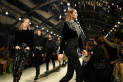 (EDITORIAL USE ONLY) Gigi Hadid walks the runway with models during the Isabel Marant show as part of the Paris Fashion Week Womenswear Fall/Winter 2020/2021 on February 27, 2020 in Paris, France.