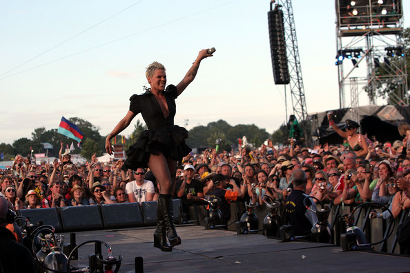 Pink Pink performs on the main stage during day three of the Isle of Wight Festival 2010 at Seaclose Park on June 13, 2010 in Newport, Isle of Wight. The festival, now in it's ninth year after being reincarnated in 2002 is attended by 50,000 music fans, which features headline acts Jay Z, The Strokes and Sir Paul McCartney.