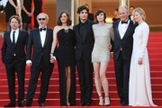 (FromL) French actor Mathieu Amalric, French director Arnaud Desplechin, French actress Marion Cotillard, French actor Louis Garrel, French actress Charlotte Gainsbourg, French actor Hippolyte Girardot and Italian actress Alba Rohrwacher pose as they arrive on May 17, 2017 for the screening of their film 'Ismael's Ghosts' (Les Fantomes d'Ismael) during the opening ceremony of the 70th edition of the Cannes Film Festival in Cannes, southern France.  / AFP PHOTO / Valery HACHE