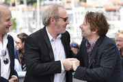 French director Arnaud Desplechin (C) and French actor Mathieu Amalric (R) pose with French actor Hippolyte Girardot on May 17, 2017 during a photocall for the film 'Ismael's Ghosts' (Les Fantomes d'Ismael) ahead of the opening ceremony of the 70th edition of the Cannes Film Festival in Cannes, southern France.  / AFP PHOTO / Alberto PIZZOLI
