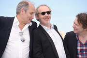 """(L-R) Actors Hippolyte Girardot, director Arnaud Desplechin and Mathieu Amalric attend the """"Ismael's Ghosts (Les Fantomes d'Ismael)"""" photocall during the 70th annual Cannes Film Festival at Palais des Festivals on May 17, 2017 in Cannes, France."""