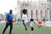 Clarence Seedorf (L) attends a football clinic for integration organized by Italian Football Federation on June 22, 2017 in Milan, Italy.