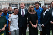 (L-R) Aron Winter, Edgar Davids, King Willem-Alexander of the Netherlands, Queen Maxima of the Netherlands, Pierre van Hooijdonk and Clarence Seedorf attend a football clinic for integration organized by Italian Football Federation on June 22, 2017 in Milan, Italy.