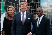 King Willem-Alexander of the Netherlands (C) Queen Maxima of the Netherlands (L) and Clarence Seedorf attend a football clinic for integration organized by Italian Football Federation on June 22, 2017 in Milan, Italy.