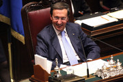 Italian Lower house speaker Gianfranco Fini smiles during a debate for the confidence vote to the Berlusconi's government at the Lower house on December 13, 2010 in Rome, Italy. Italian Prime Minister Silvio Berlusconi is facing a vote of no confidence from both the Senate and the Lower House.