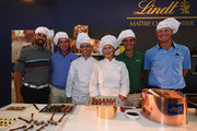 Alvaro Quiros of Spain, Gonzalo Fernandez Castano of Spain, Matteo Manassero  of Italy and Fredrik Andersson-Hed of Sweden discover how Lindt chocolates are made after the pro-am prior to the start of the Italian Open golf at Circolo Golf Torino on September 18, 2013 in Turin, Italy.