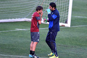 Coach Antonio Conte (L) and Gianluigi Buffon during Italy Training Session at Coverciano on September 6, 2014 in Florence, Italy.