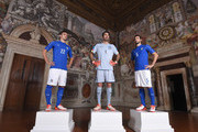 (L-R) Manolo Gabbiadini, Gianluigi Buffon and Davide Astori pose during the launch of new Puma home kit at Palazzo Vecchio on November 9, 2015 in Florence, Italy.