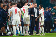 Gareth Southgate, Head Coach of England speaks with Harry Maguire and Raheem Sterling of England during half time of extra time during the UEFA Euro 2020 Championship Final between Italy and England at Wembley Stadium on July 11, 2021 in London, England.
