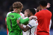 Jordan Pickford and Raheem Sterling of England look dejected following defeat in the UEFA Euro 2020 Championship Final between Italy and England at Wembley Stadium on July 11, 2021 in London, England.
