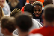 Raheem Sterling of England is consoled by a family member following defeat in the UEFA Euro 2020 Championship Final between Italy and England at Wembley Stadium on July 11, 2021 in London, England.
