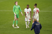 Jordan Pickford, Raheem Sterling and Kalvin Phillips of England look dejected following defeat in the UEFA Euro 2020 Championship Final between Italy and England at Wembley Stadium on July 11, 2021 in London, England.