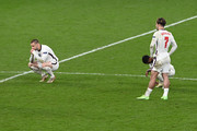 Luke Shaw, Raheem Sterling and Jack Grealish of England look dejected following their team's defeat in the UEFA Euro 2020 Championship Final between Italy and England at Wembley Stadium on July 11, 2021 in London, England.