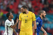 Raheem Sterling of England confronts Gianluigi Donnarumma of Italy during the UEFA Euro 2020 Championship Final between Italy and England at Wembley Stadium on July 11, 2021 in London, England.