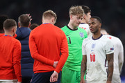 Jordan Pickford and Raheem Sterling of England look dejected following the UEFA Euro 2020 Championship Final between Italy and England at Wembley Stadium on July 11, 2021 in London, England.