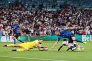 Raheem Sterling of England is challenged by Leonardo Bonucci of Italy as Gianluigi Donnarumma of Italy collects the ball during the UEFA Euro 2020 Championship Final between Italy and England at Wembley Stadium on July 11, 2021 in London, England.