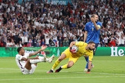 Raheem Sterling of England reacts after being challenged in the box as Gianluigi Donnarumma of Italy collects the ball during the UEFA Euro 2020 Championship Final between Italy and England at Wembley Stadium on July 11, 2021 in London, England.