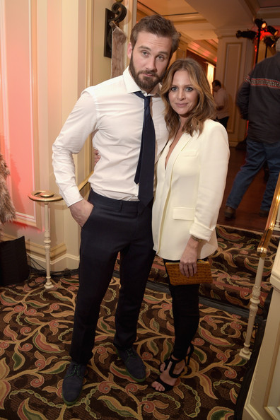 Actors Clive Standen (L) and Jessalyn Gilsig attend the JAN 2015 TCA History Vikings Party on January 9, 2015 in Pasadena, California.